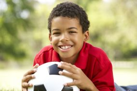 6456227 - boy in park with football